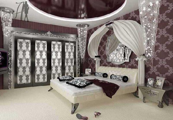 кровать в роскошном интерьере спальни