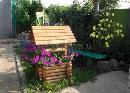 необычная цветочная клумба возле дома