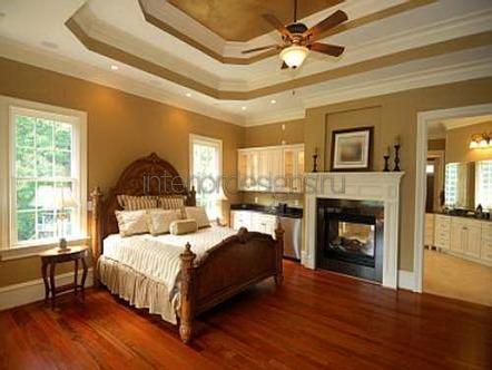 камин в дизайне спальни
