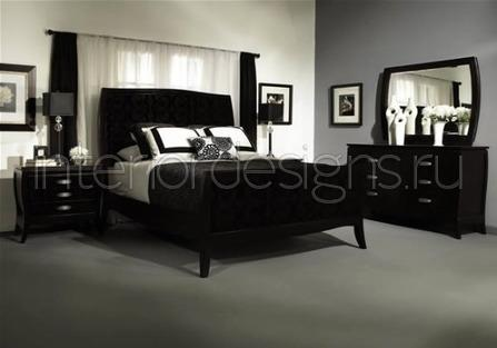 Grey bedroom with black furniture